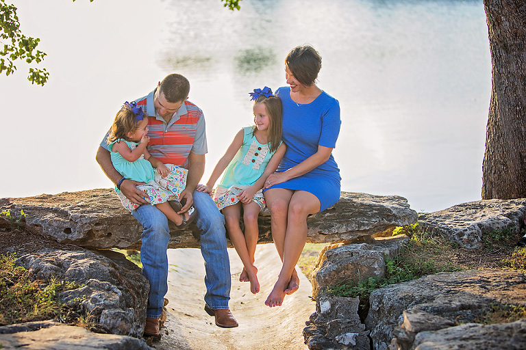 Family of four photo session on the water at sunset How to Find Perfect Austin Family Photo Locations
