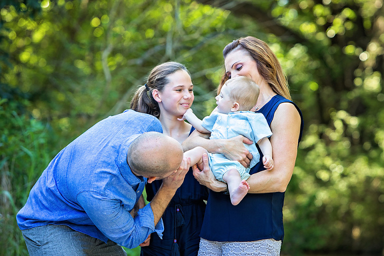 Family of four with two children in blue outfits at Mary Moore Searight Park in Austin Texas How to Find Perfect Austin Family Photo Locations