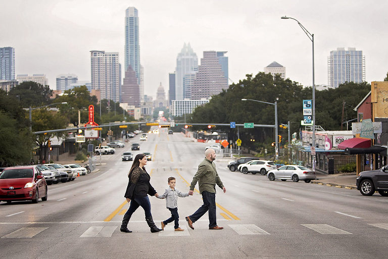Best Times to Book Outdoor Portrait Photography South Congress Avenue family walking across street with Texas State Capitol in the background
