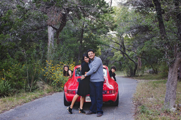 red Porsche family of four Austin family photographers black dress stylish mom
