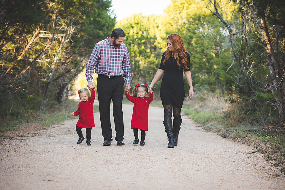 Austin family photographer at Mary Moore Searight Park wearing red and black outfits