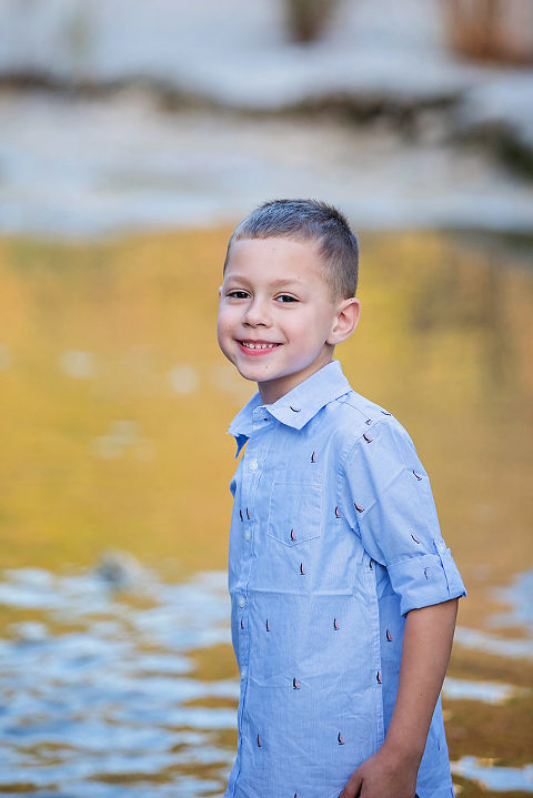 Best Times To Book Outdoor Portrait Photography Boy Standing In Water At Bull Creek Park