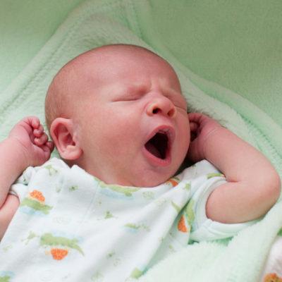Austin Lifestyle Newborn photographer newborn yawning in crib