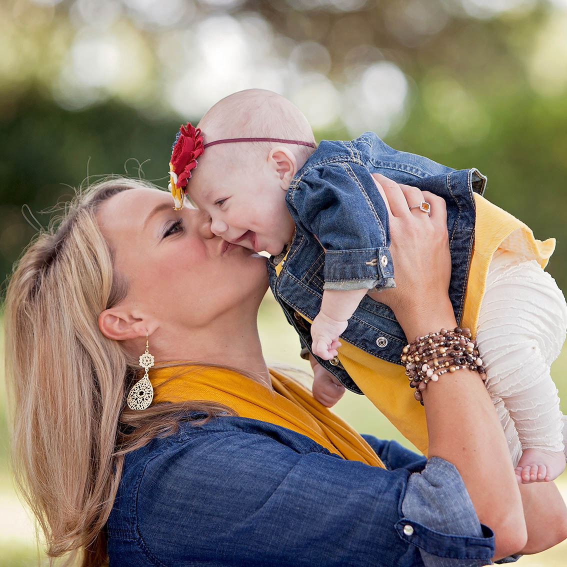 Austin family photography mom kissing happy baby