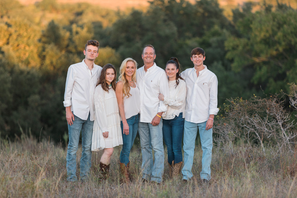 Austin Family Photographer family of six smiling together